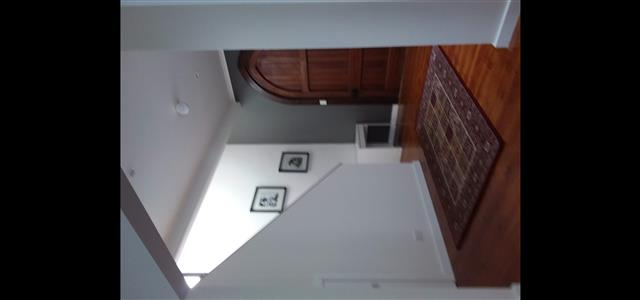 Staircase from front entrance leading to upstairs sleeping