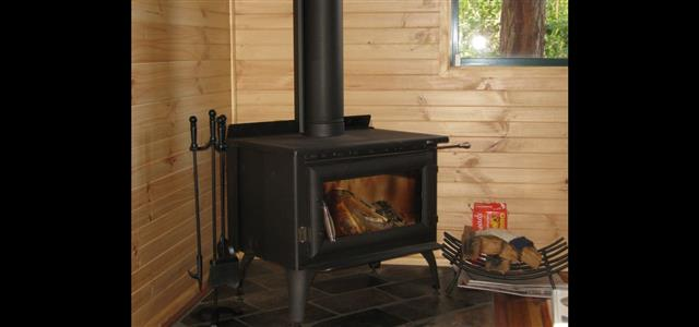 Deluxe King Spa Chalet logfire.